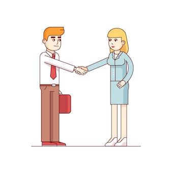Homem e mulher de negócios apertando as mãos