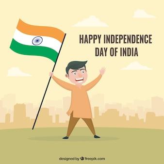 Homem indiano comemorando o dia da independência com uma bandeira