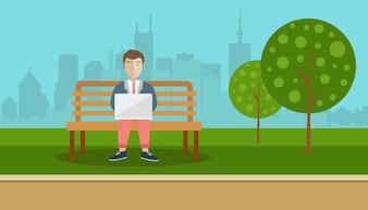 Homem sentado em um parque