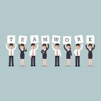 """Homens e mulheres de negócios com a palavra """"trabalho em equipe"""""""