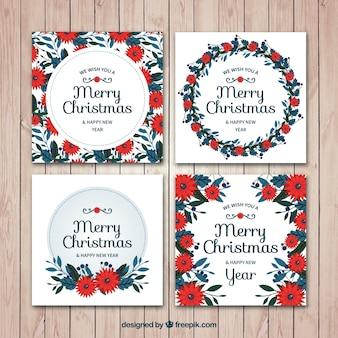 Jogo das alegres cartões de Natal e Ano Novo com flores no estilo do vintage