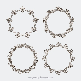 Jogo de quatro coroas de flores desenhadas à mão