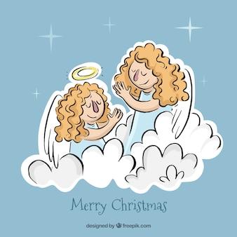 Jogo dos anjos do natal orando nas nuvens