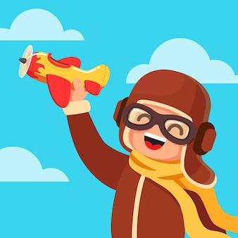 Kid vestido como um piloto jogando com avião de brinquedo