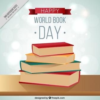 Livros da pilha no livro mundo Fundo do dia