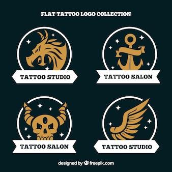 Logos dourados do estúdio de tatuagem