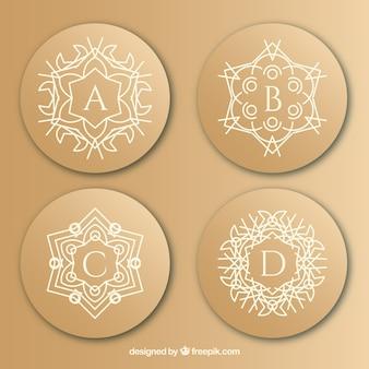 Logotipo das letras maiúsculas ornamentais