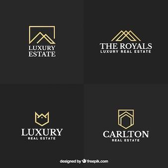 Luxo e elegantes logotipos imobiliários