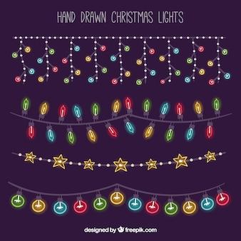 Luzes de Natal desenhadas a mão sobre um fundo roxo