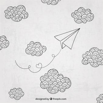 Mão avião de papel desenhado e nuvens