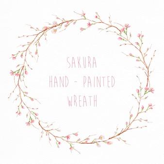 Mão coroa de flores de sakura pintado