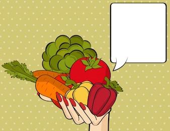 Mão da mulher com muitos vegetais