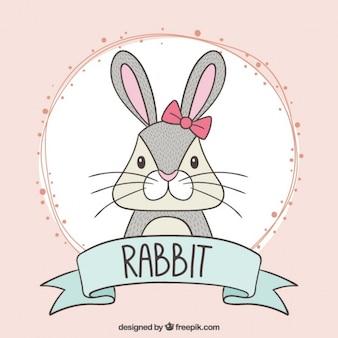 Mão do coelho desenhada com um laço rosa