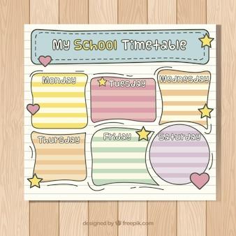 Mão horário escolar desenhado em uma folha do caderno