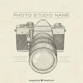 Mão logotipo do estúdio tirado foto retro