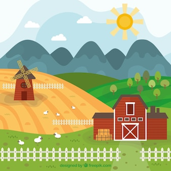 Mão moinho tirado e paisagem da exploração agrícola com cerca
