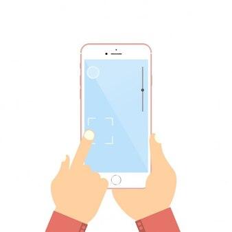 Mão que prende o telefone móvel no estilo design plano