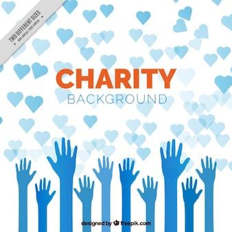 mãos azuis com fundo dos corações de caridade