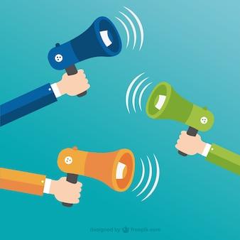Mãos segurando megafones