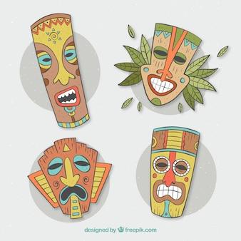 Máscaras tiki desenhadas a mão com estilo tribal