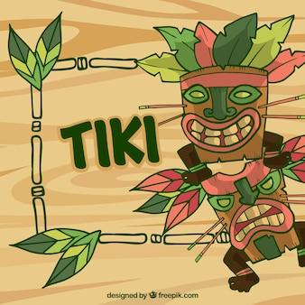 Máscaras tiki desenhadas à mão e armação de bambu