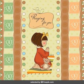 Menina bonito orando no fundo do scrapbook