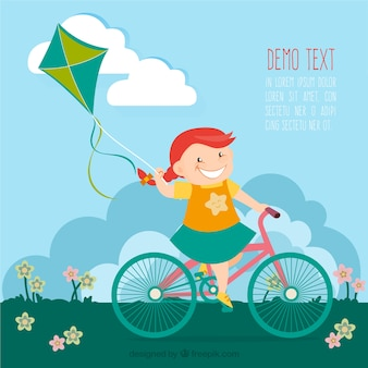 Menina na bicicleta com um papagaio