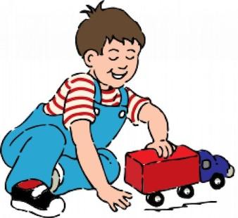 menino brincando com o caminhão de brinquedo