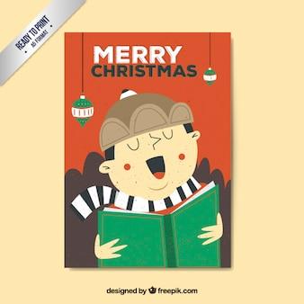 Menino que canta um cartão christmas carol