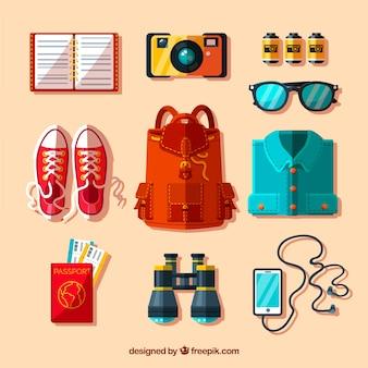 Mochila e outros elementos de viagem em design plano