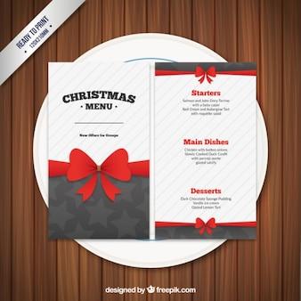 Molde do menu do Natal com uma fita