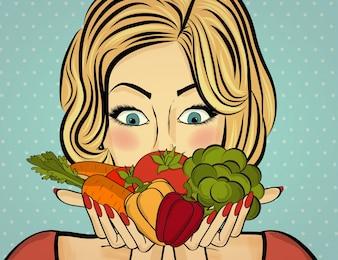 Mulher loura sexy com muitos vegetais em suas mãos