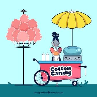 Mulher que vende algodão doce no parque