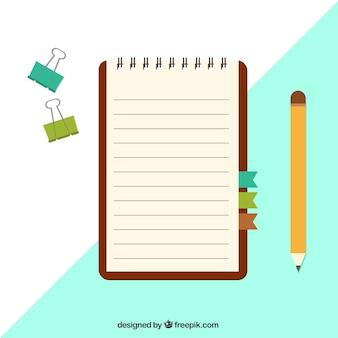 Notebook com grampos e lápis no design plano