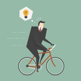 O homem de negócios que monta uma bicicleta
