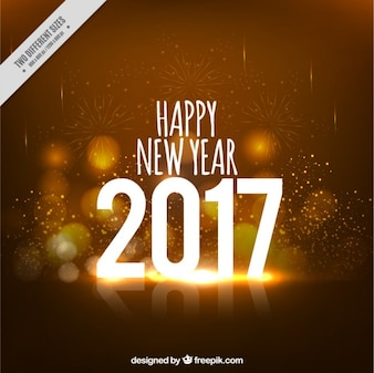 Ouro Sparkling do ano novo fundo