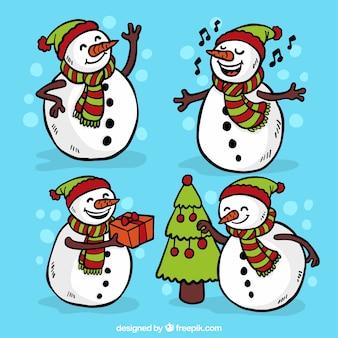 Pacote de mão agradável desenhada bonecos de neve com chapéus