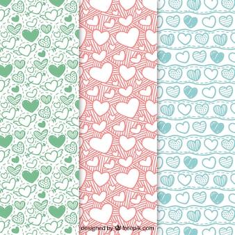 Pacote de mão desenhada padrões corações