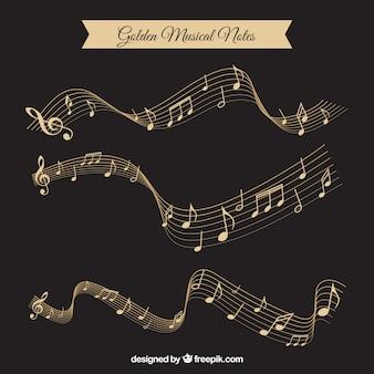 Pacote de Ouro de notas musicais e pentagramas