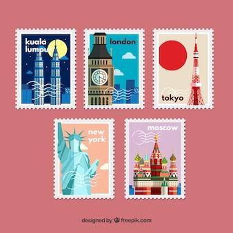 Pacote de selos retros em design plano com monumentos