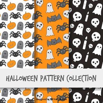 Pacote de três padrões desenhados mão de Halloween