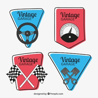 Pacote desenhado mão de quatro logotipos de carros antigos