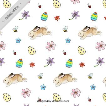 Padrão de Easter com coelhos e ovos no estilo da aguarela