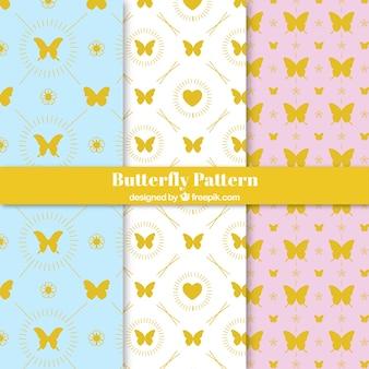 Padrões de borboletas douradas definidas