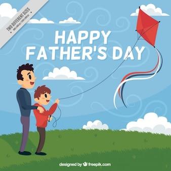 Pai e filho empinando uma pipa