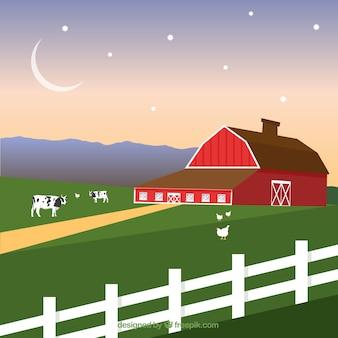 Paisagem da exploração agrícola com o celeiro vermelho