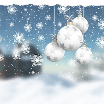 Pendurando enfeites de Natal em uma paisagem de inverno defocussed