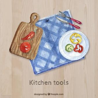 Pintados à mão as ferramentas da cozinha em uma tabela