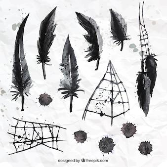 Pintados à mão penas pretas e teia de aranha