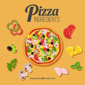 Pizza com ingredientes ao redor